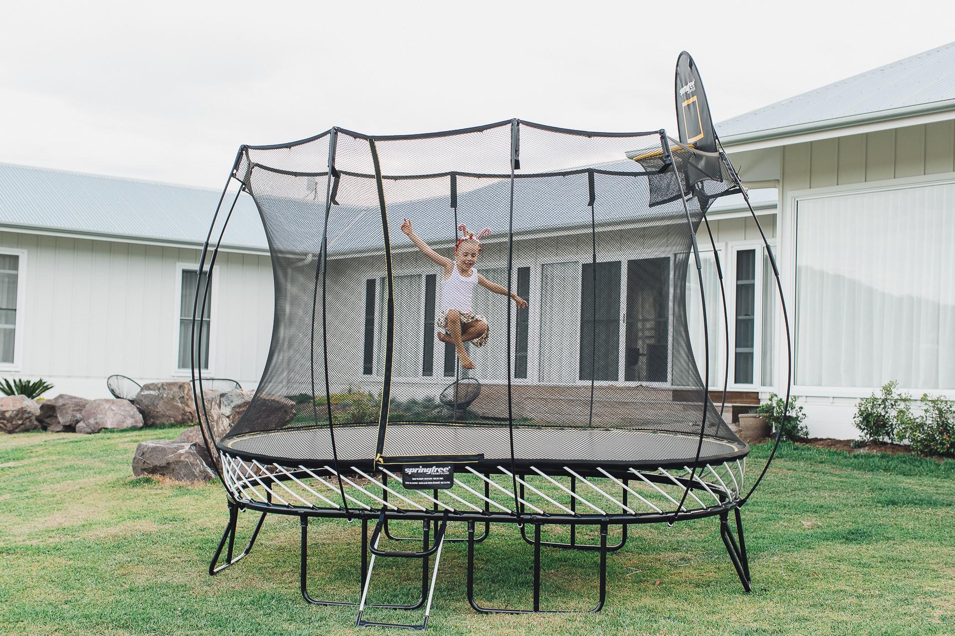 Child jumps on trampoline